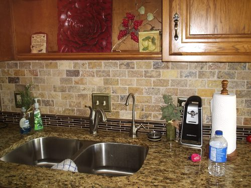Kitchen backsplash with glass tile and limestone