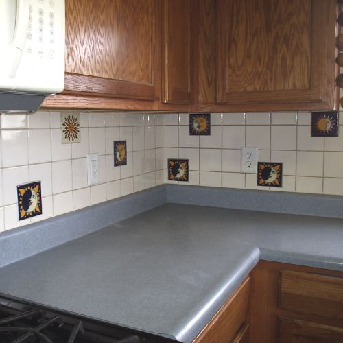 kitchen backsplash, hand-made tiles scattered throughout. Bright colors.