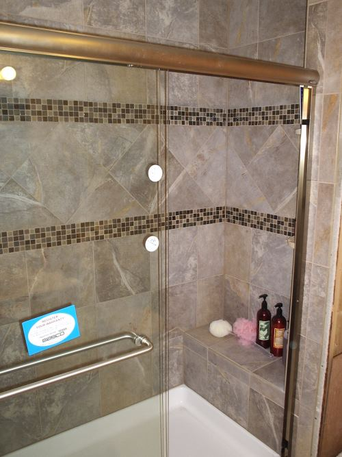 Another photo of a fancy tiled shower